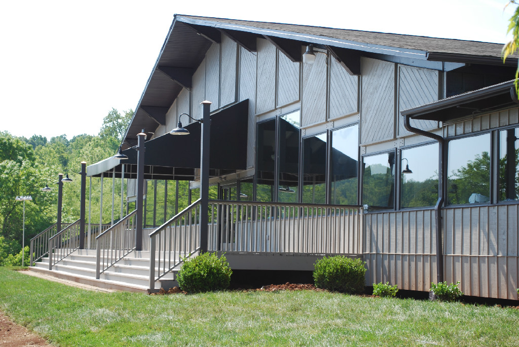 Access the generous porch area from The Main Event room - located on the pond side of the facility.